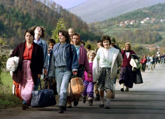 Bosnian women carrying their belongings flee Jajce, Bosnia and Herzegovina, on Oct. 31, 1992. PATRICK BAZ/AFP/GETTY IMAGES